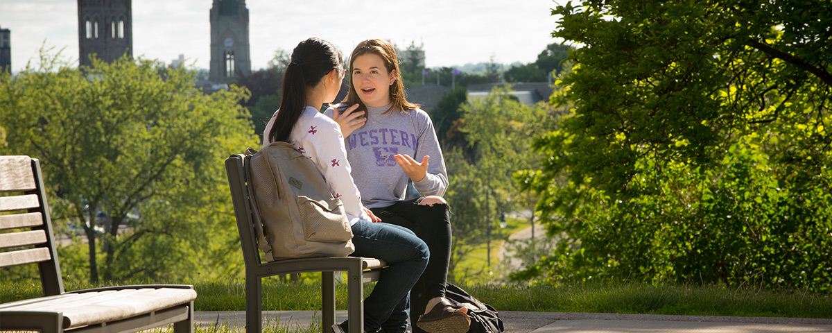 Students talking in front of Western campus