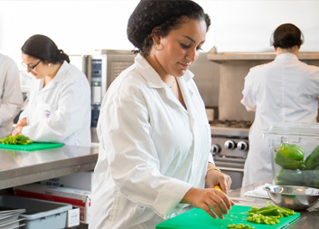 Student working in commercial kitchen