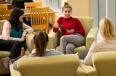 Students sitting in lounge in the library