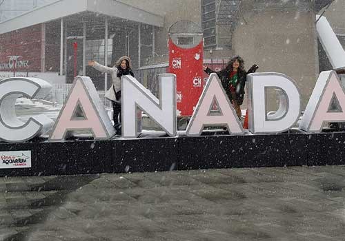 Students in front of a Canada sign.