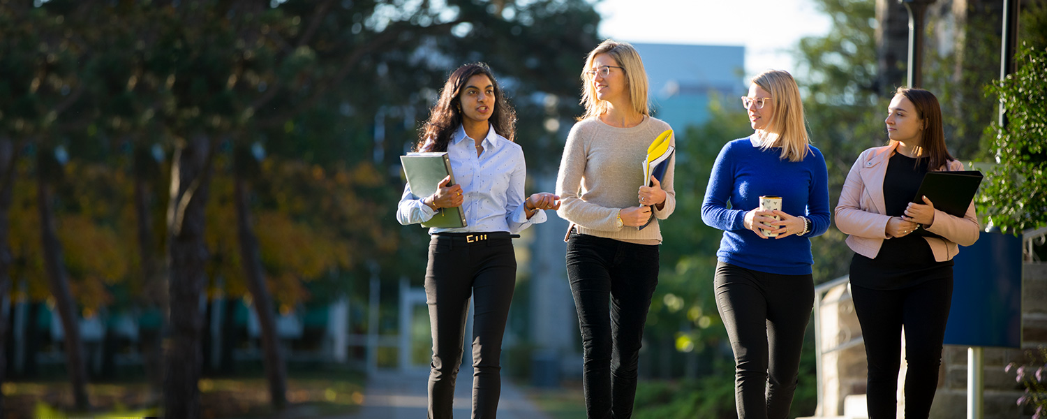 Narmata Naguleswaran, Rhea Johnson, Caitlin Core and Emily Morphy from Bresica's Communications team walking outdoors