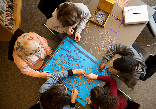 Students doing a puzzle together in the library